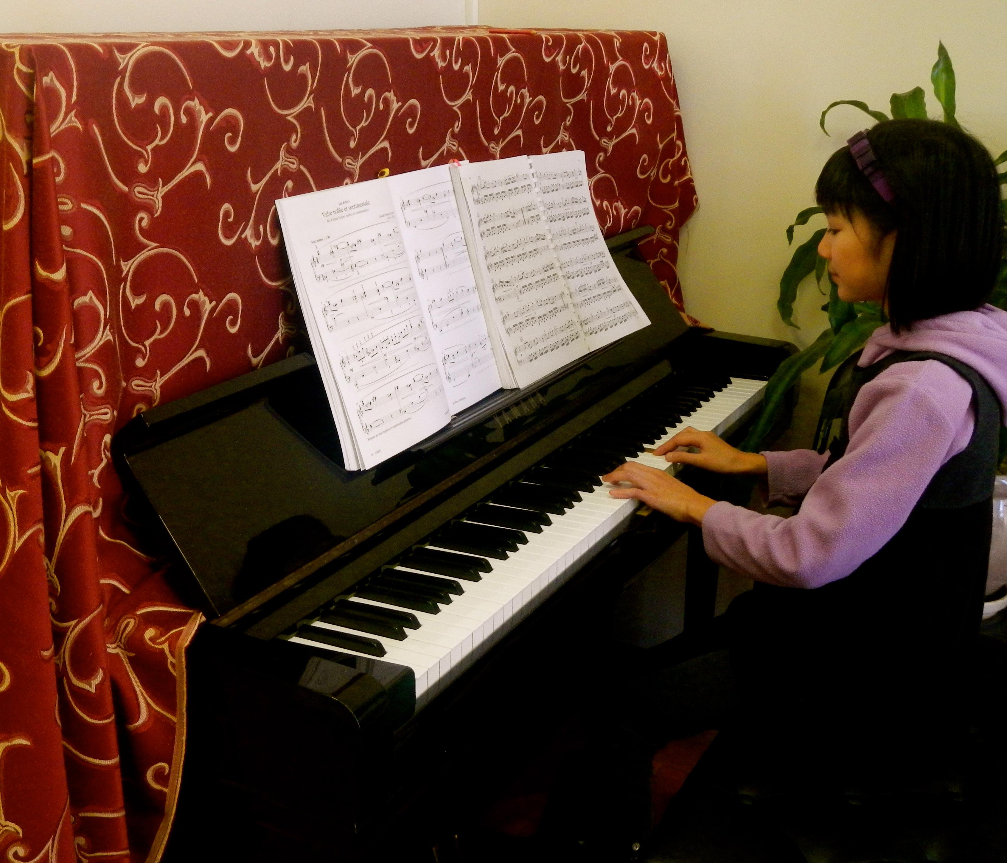 2 Datrisha playing Piano