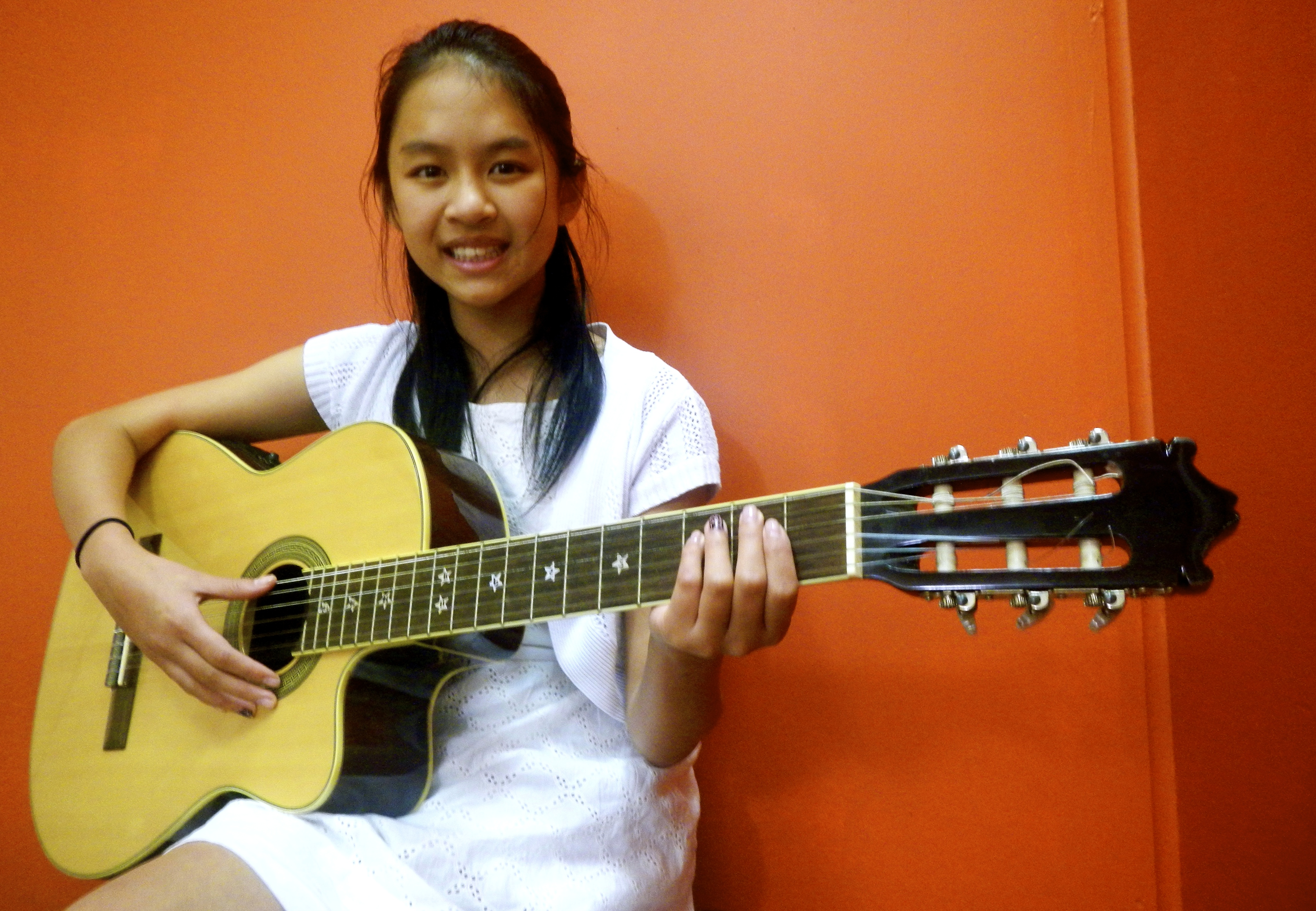 Kimberly Luong on Guitar